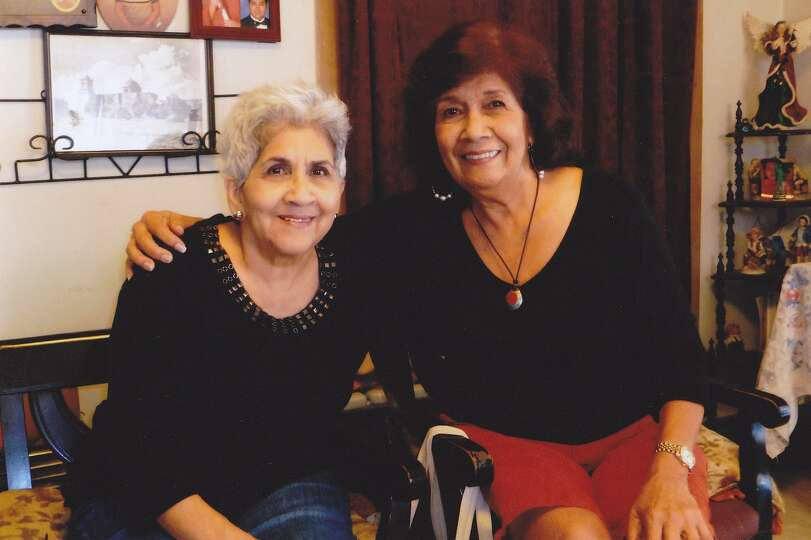 Helen R. Hernandez, 73, and her sister Esther R. Garcia, 74, pose in late October in their mother's