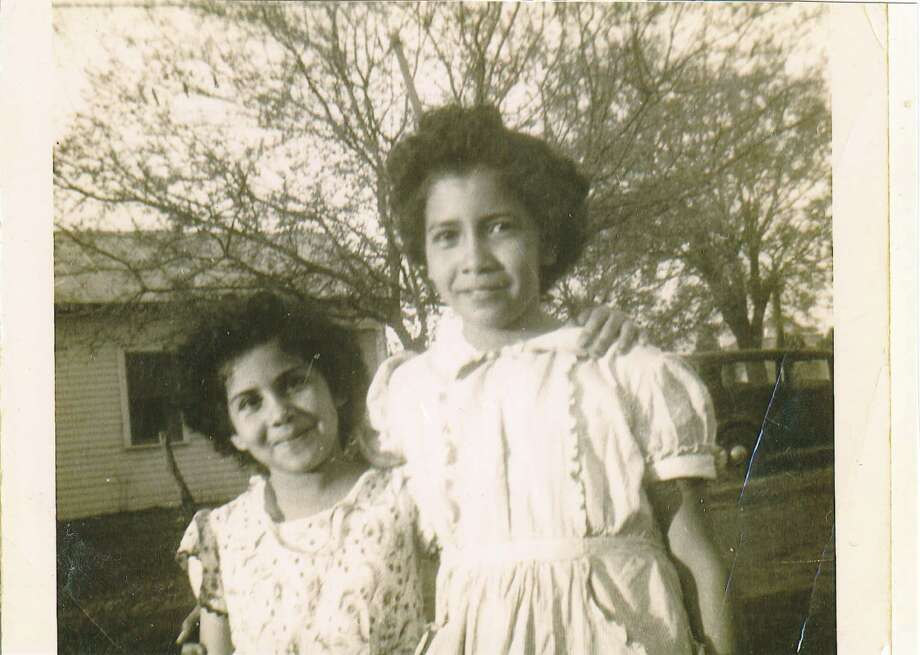 Then: Sisters Helen and Esther Rodulfo pose for a photo in 1946 at grandmother s house. For many years, their parents Raul and Eudelia owned Rodulfo s Grocery and Meat market on Probandt and Lone Star Blvd. Photo: Esther Garcia, Reader Submission