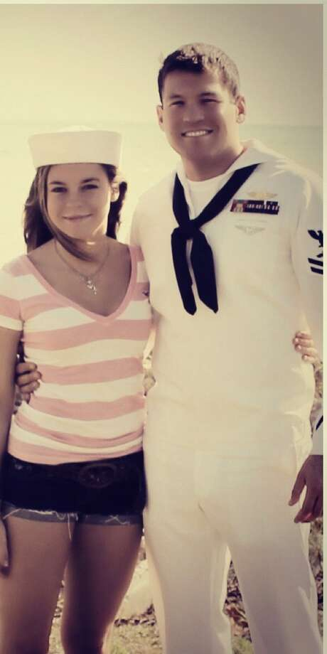 Then:Cody Cox, 26, and his sister Madison, 13, celebrate Veterans Day last year in Key West, where he is stationed. In 2005, the siblings posed for a similar photo in Pensacola, Fla., to celebrate Cody s graduation as a search and rescue swimmer. Cody is a graduate of Bandera High School. Photo: Courtesy Photo