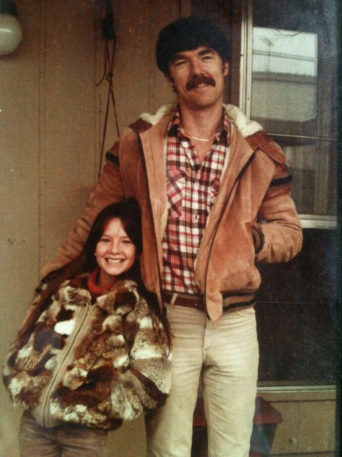 Then: William King poses with his 10-year-old daughter Courtney (the  apple of my eye  he writes) outside his San Antonio home in 1982. Photo: Courtesy Photo