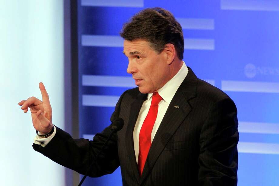 Texas Gov. Rick Perry answers a question during a Republican presidential candidate debate at Saint Anselm College in Manchester, N.H., Saturday, Jan. 7, 2012. Photo: Elise Amendola, Associated Press / AP
