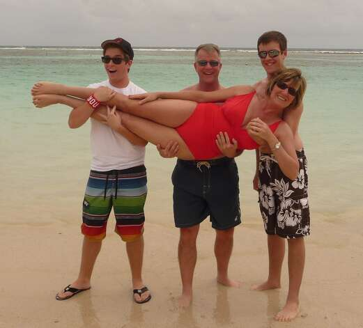 During a family cruise back in 2008, the Scott boys, Braden, 14, and Garrett, 13, engaged in a little horseplay with their dad David and mom Mandy on the beach in Cozumel. On a more recent cruise in December 2011, the boys, dad and mom re-create the original beach pose, this time on the beach in Costa Maya, Mexico.  It is amazing to see how much the boys have changed in such a relatively short time,  Mandy writes.  Of course, David and I don t look a day older! Photo: Mandy Scott, Reader Submission