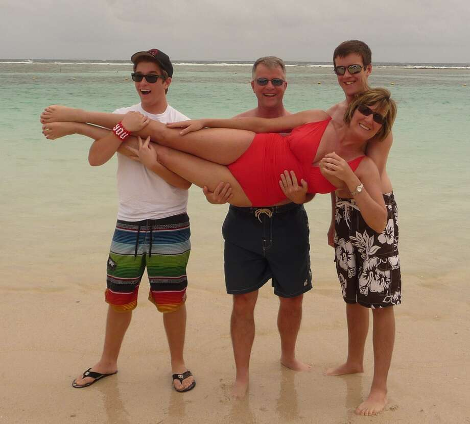 Now: During a family cruise back in 2008, the Scott boys, Braden, 14, and Garrett, 13, engaged in a little horseplay with their dad David and mom Mandy on the beach in Cozumel. On a more recent cruise in December 2011, the boys, dad and mom re-create the original beach pose, this time on the beach in Costa Maya, Mexico.  It is amazing to see how much the boys have changed in such a relatively short time,  Mandy writes.  Of course, David and I don t look a day older! Photo: Courtesy Photo, Mandy Scott, Reader Submission