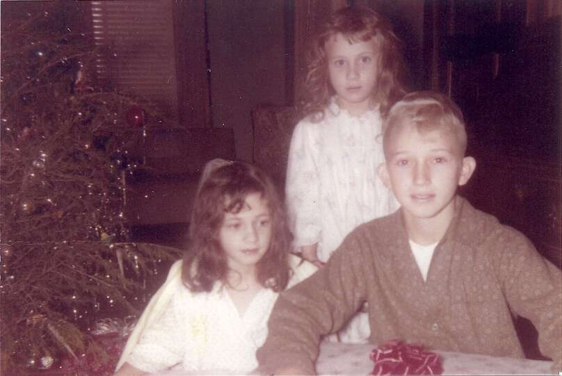 Pictured left to right: Kathleen, 6, Jackie, 5, and Rick Perrett, 10. The photo is of my husband Ric