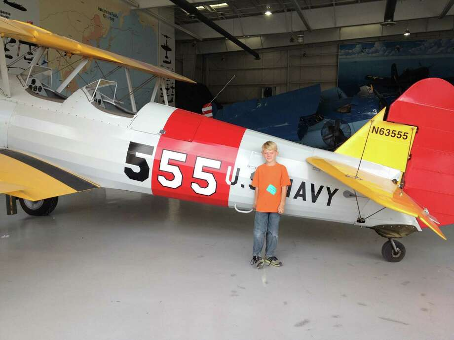 Now:October, 2012. Ray White s great grandson, Joshua Pierce, 8, is stands in front of a Stearman PT-17 at the Palm Springs Air Museum in Palm Springs, Calif. The PT-17 is the same type of plane his great-grandfather, Ray S. White, trained in during WWII.