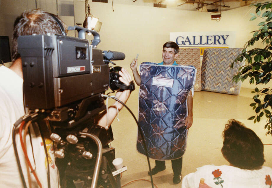 He's called Mattress Mack because he used to wear a mattress in his Gallery Furniture commercials. Here he is in 1990, filming one. Photo: Carlos Rios, . / Houston Chronicle