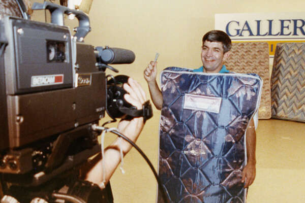 He's called Mattress Mack because he used to wear a mattress in his Gallery Furniture commercials. Here he is in 1990, filming one.