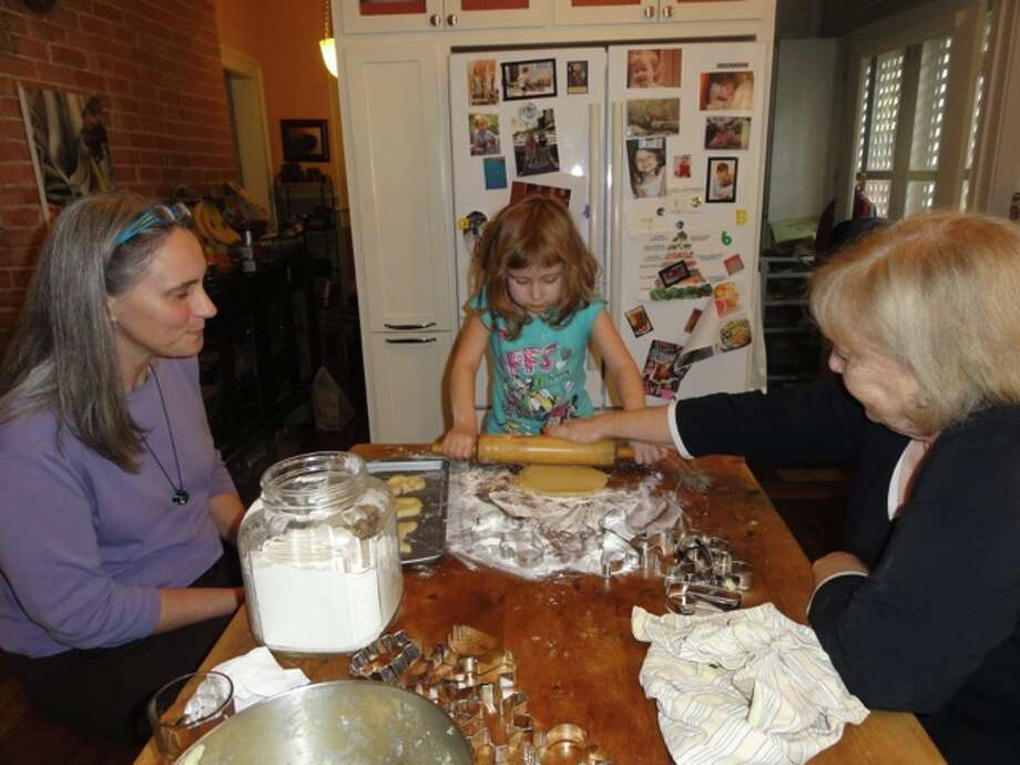 Twenty-four years after David Cotrell was photographed making Christmas cookies in the kitchen of his home on W. Craig Place in San Antonio, his daughter Aubrey, 4, makes Christmas cookies in the same kitchen. This 102-year-old house has been our family home for 36 years.