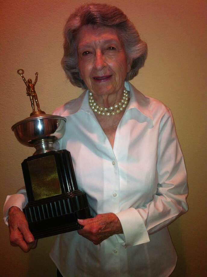 "Now: In 1946, Frances Perl won a trophy reading ""1946 Memorial Award presented by Brownsville Lions Club for Outstanding Achievements to Frances Perl."" Sixty-six years later she again poses with the trophy.