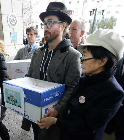 Sean Lennon and Yoko Ono, representing Artists Against Fracking, joined other activist groups as they went to the Environmental Conservation building Jan. 11, 2013 in Albany, N.Y.     (Skip Dickstein/Times Union) Photo: SKIP DICKSTEIN / 00020738A
