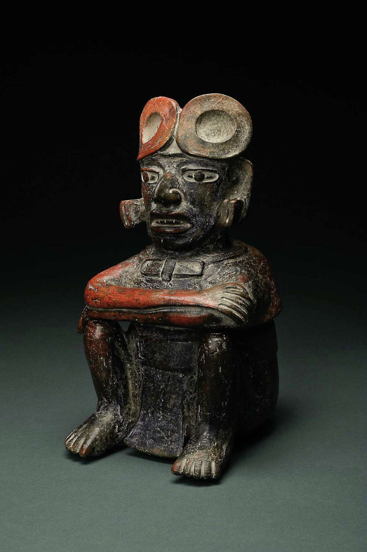 Vessel in the Form of a Warrior With Arms Crossed, an ancient Mayan work from Guatemala, is one of the highlights of the SAMA collection featured in the museum's new handbook