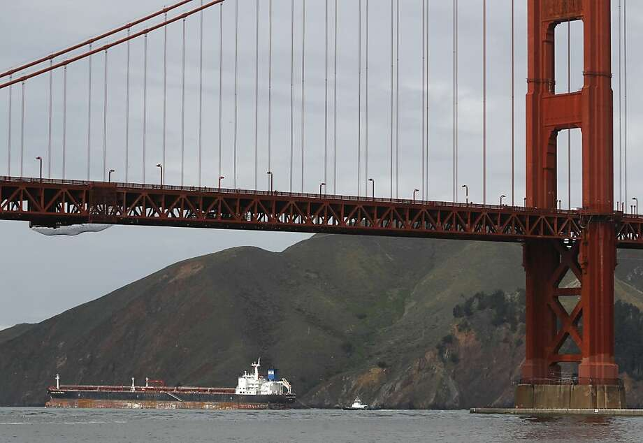 The Overseas Reymar passes the Marin Headlands after the oil tanker sailed under the Golden Gate Bridge in San Francisco, Calif. on Friday, Jan. 11, 2013. The 752-foot vessel was cleared to sail by the Coast Guard after it collided with a Bay Bridge tower in fog on Monday. Photo: Paul Chinn, The Chronicle