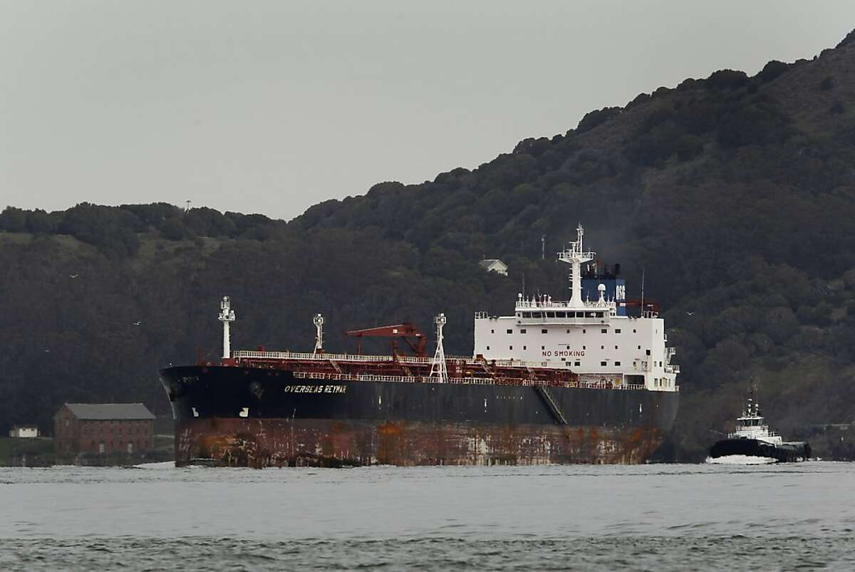 The Overseas Reymar sails past Angel Island as the 752-foot oil tanker leaves San Francisco Bay on Friday, Jan. 11, 2013. The Coast Guard cleared the tanker to leave after it collided with a Bay Bridge tower in the fog on Monday.