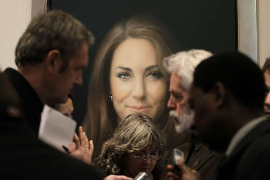 """Thumbs up or down?Reporters surround artist Paul Emsley, who painted the newly commissioned portrait of the Duchess of Cambridge at the National Portrait Gallery in London. Some of the adjectives used to describe it are """"lifeless,"""" """"dull,"""" """"unpleasant"""" and """"ghastly."""" To be fair, some critics praised the work, and the duchess likes it. Photo: Sang Tan, Associated Press"""