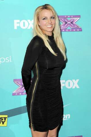 "FILE - This Nov. 5, 2012 file photo shows singer and celebrity judge Britney Spears at the ""X-Factor"" Finalists Party in Los Angeles. A person familiar with plans for Fox's ""The X Factor"" says Britney Spears is out of the show. Spears was a mentor on the singing contest for one season, reportedly drawing a $15 million paycheck but failing to pull reviews to match. The person who confirmed reports of her departure wasn't authorized to comment publicly, speaking Thursday on condition of anonymity. (Photo by Jordan Strauss/Invision/AP, file) Photo: Jordan Strauss"