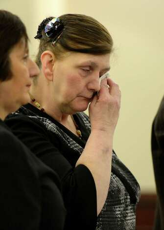 LuAnn Burgess wipes tears from her eyes during her sentencing by Judge Stephen Herrick Friday morning, Jan. 11, 2013, at the Albany County Courthouse in Albany, N.Y.   Burgess pled guilty to three counts of criminally negligent homicide and agreed to never drive again.    (Skip Dickstein/Times Union) Photo: SKIP DICKSTEIN / 00020706A