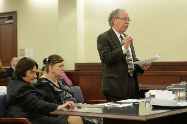 Defense attorney Larry Rosen, right, pleads for leniency as LuAnn Burgess, center, sits quietly during her sentencing by Judge Stephen Herrick Friday morning, Jan. 11, 2013, at the Albany County Courthouse in Albany, N.Y.   Burgess pled guilty to three counts of criminally negligent homicide and agreed to never drive again. (Skip Dickstein/Times Union) Photo: SKIP DICKSTEIN / 00020706A
