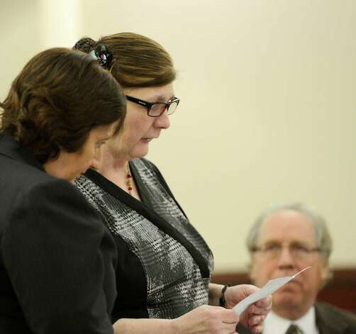 LuAnn Burgess reads her personal statement during her sentencing by Judge Stephen Herrick Friday morning, Jan. 11, 2013, at the Albany County Courthouse in Albany, N.Y.   Burgess pled guilty to three counts of criminally negligent homicide and agreed to never drive again.  With Burgess are her defense attorneys Cheryl Coleman, left, and Larry Rosen, right.   (Skip Dickstein/Times Union) Photo: SKIP DICKSTEIN / 00020706A