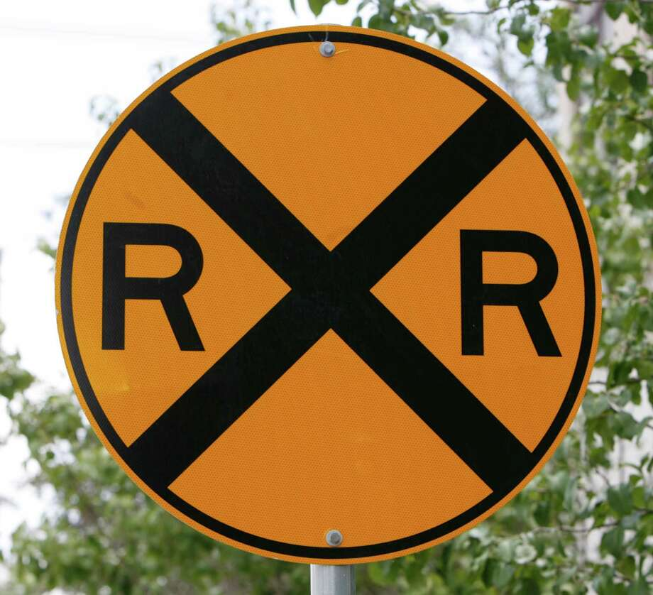 Railroad crossing warning sign on San Felipe near East Briar Hollow Tuesday, July 11,  2006.  This is one of 14 crossing in certain residential areas of Houston, Bellaire and West University Place that have been declared railroad quiet zones. Trains will not have to sound their horns while passing through the quiet zones.  ( Melissa Phillip / Chronicle) Photo: MELISSA PHILLIP, STAFF / Houston Chronicle