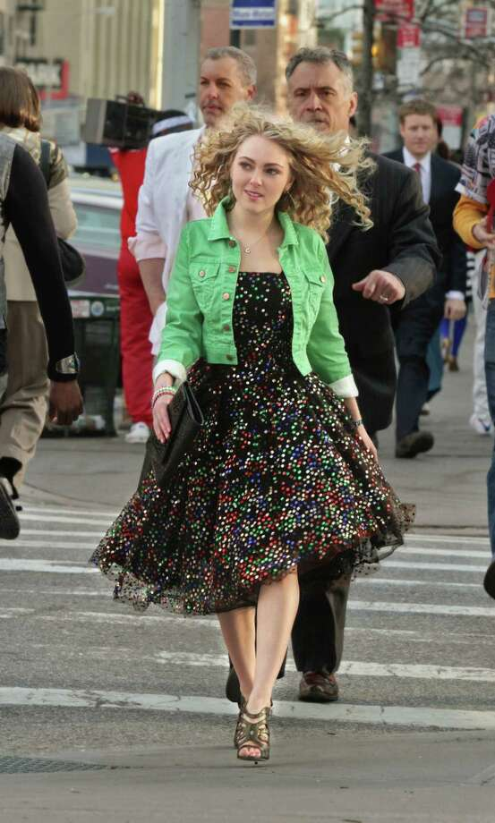 """This undated image released by The CW shows AnnaSophia Robb as Carrie Bradshaw in """"The Carrie Diaries.""""  The new hour-long drama premieres Monday at 8 p.m. EST on the CW. (AP Photo/The CW) Photo: Associated Press / The CW"""