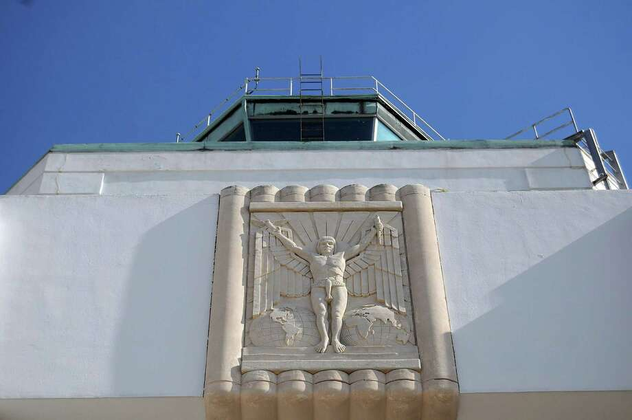 """A tiny airplane serves as a loincloth on the """"Winged Mercury"""" relief on the 1940 Air Terminal Museum at Hobby Airport. Photo: Dave Rossman, Freelance / © 2012 Dave Rossman"""