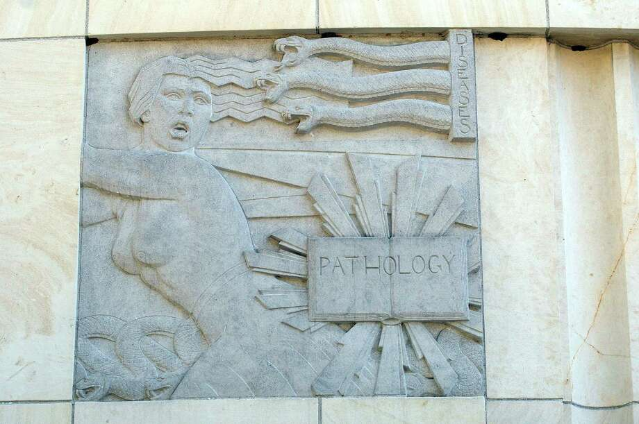 "The ""Pathology"" bas-relief on the Roy and Lillie Cullen Building in the Medical Center Sunday Jan. 06, 2013.(Dave Rossman/For the Chronicle) Photo: Dave Rossman, Freelance / © 2012 Dave Rossman"