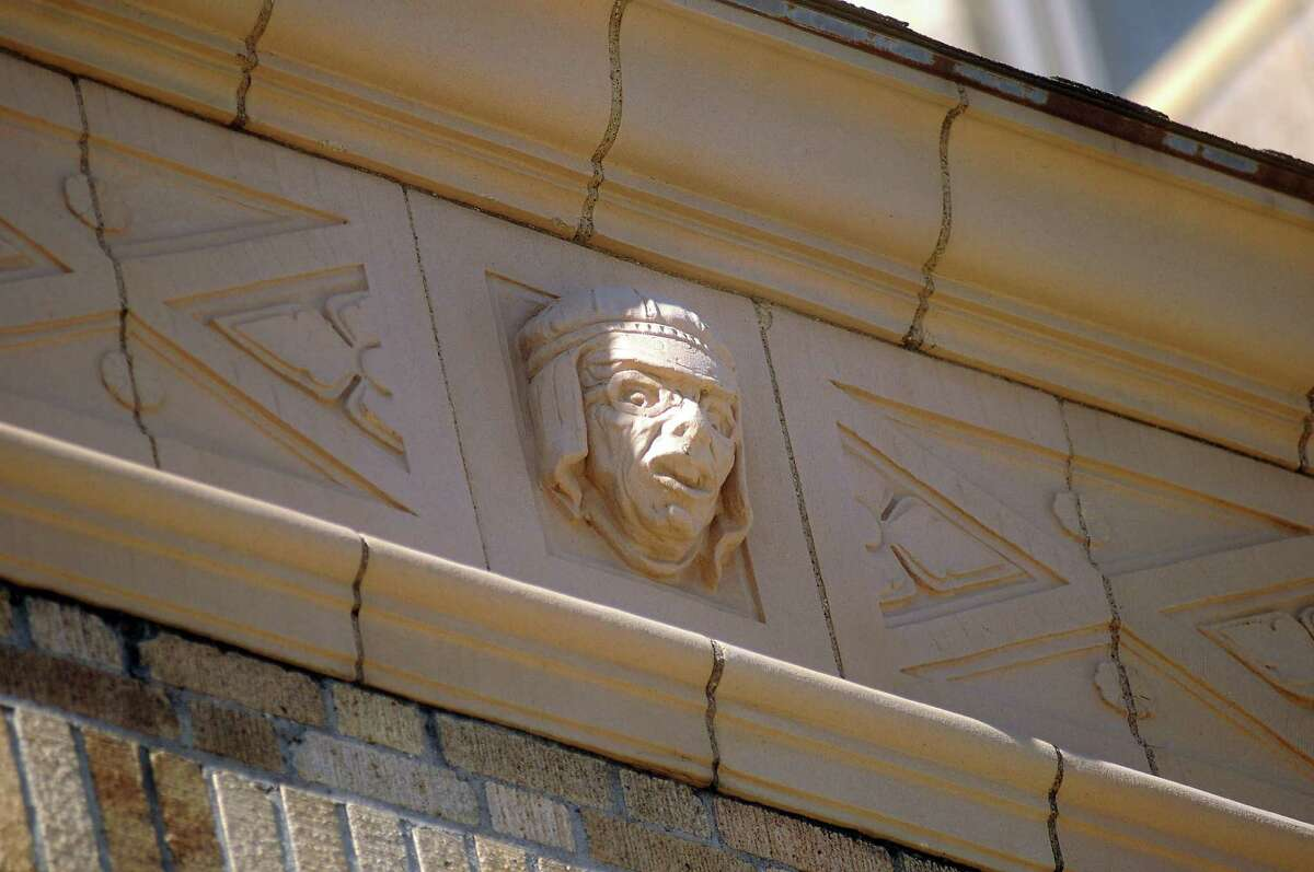 A relief on the Great Southwest Building parking garage downtown represents a driver.