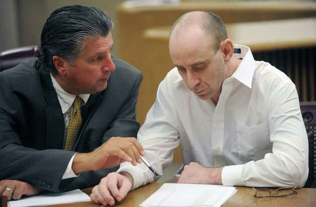 "Joseph ""Jimmie"" Desormeaux, right, who is accused of killing 24-year old Summer Bourque in August 2008, listens as his attorney Thomas Burbank, left, points out something about the paperwork in front of him Monday afternoon.  Bourque's body was found in the J.D. Murphree Wildlife Management Area in Port Arthur.  Guiseppe Barranco/The Enterprise / Beaumont"