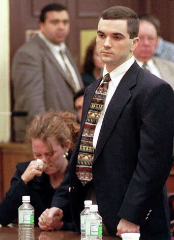 Shawn Allen Berry, 24, right, on trial for his part in the dragging death of James Byrd Jr., stands as he is sentenced to life in prison, while his fiance Christie Marcontell holds his hand Thursday, Nov. 18, 1999, in Jasper, Texas. Berry, who insisted he was just a frightened bystander, was sentenced to life in prison for one of the nation's grisliest racial crimes since the civil rights era. Berry's roommates, avowed white supremacists John William King, 25, and Lawrence Russell Brewer, 32, were sentenced to die in separate trials earlier this year. Enterprise file photo Photo: DAVE RYAN, POOL / AP1999