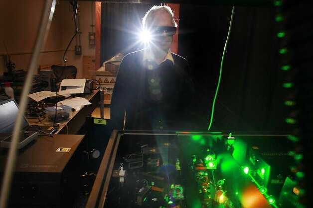 Heinz Frei, the acting director of the Joint Center for Artificial Photosynthesis, demonstrates the lasers that are being used in the center's lab in Berkeley. Photo: Mike Kepka, The Chronicle