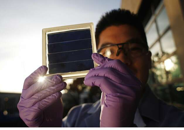 Kenny Lee, a mechanical engineer at the Joint Center for Artificial Photosynthesis holds a prototype of an artificial photosynthesis panel on Wednesday January 9, 2012 in Berkeley, Calif. JCAP has entered a race to create earth friendly fuels that some day may actual combat the effects of global warming. Photo: Mike Kepka, The Chronicle