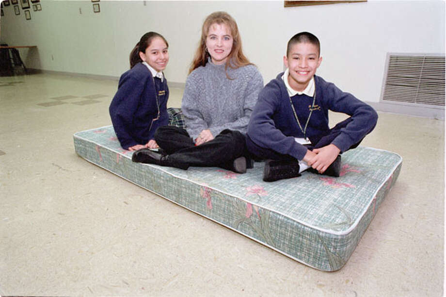 Jim McIngvale helped Saint Christopher's Catholic School students Denise Salazar, 12, Erik Munoz,13, and Lindi Juarez travel to Rome in February 2002. Photo: E. Joseph Deering, . / Houston Chronicle