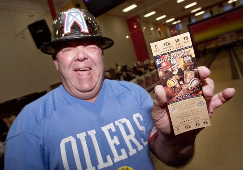 "Art Horridge, who was the Houston Oilers mascot for 25 years, holds up his Super Bowl ticket Jan. 28, 2000, provided by Jim McIngvale. ""He's a Houston legend. Everyone remembers him during the Oilers days,"" McIngvale said.  Photo: DAVID J. PHILLIP, . / AP"