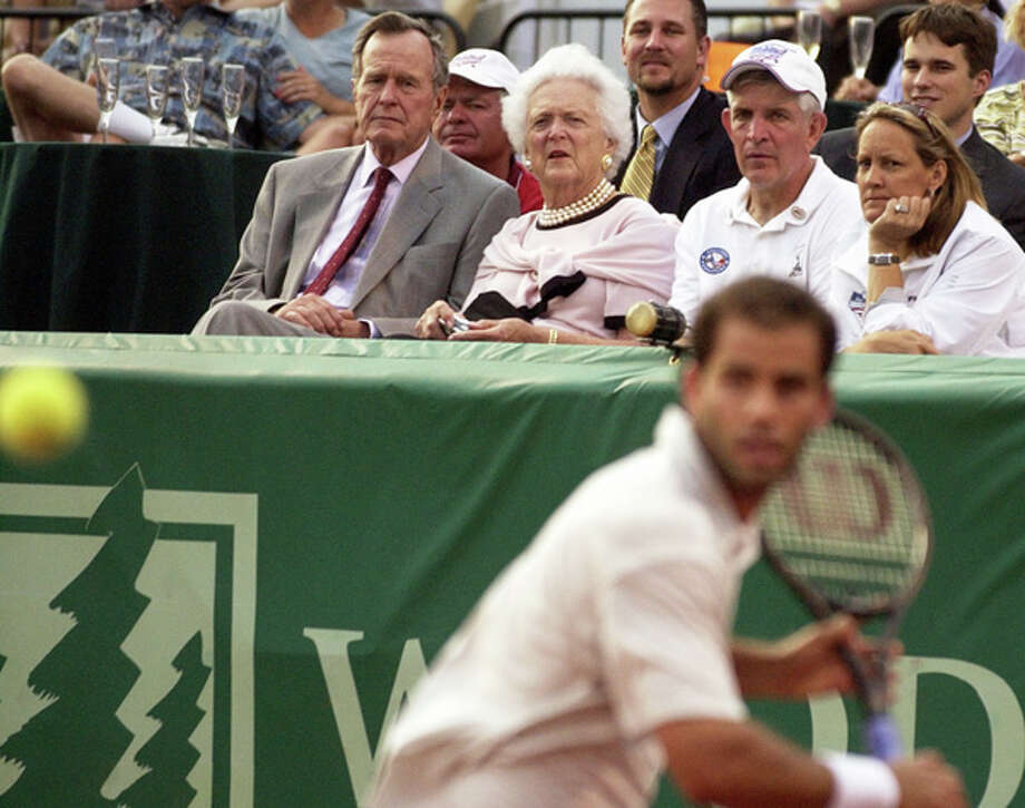 George and Barbara Bush watch with Jim and Linda McIngvale as Pete Sampras makes a return during his opening match against Jan Vacek of the Czech Republic on April 23, 2002, at the U.S. Men's Clay Court Championships at Westside Tennis Club. Related story. Photo: SMILEY N. POOL, . / HOUSTON CHRONICLE