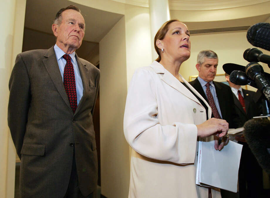 Former President George Bush listens along with Jim McIngvale as his wife, Linda, talks about tsunami fundraising efforts Jan. 5, 2005, in Houston. Related story. Photo: DAVID J. PHILLIP, . / AP
