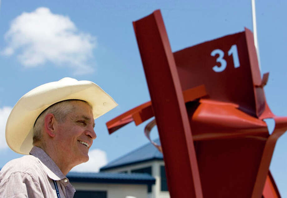 Jim McIngvale gives a speech in front of a new sculpture honoring Houston Fire Department's Station 31 on July 3, 2009, a little over a month after an arson fire destroyed the store's warehouse.  Photo: Johnny Hanson, . / Houston Chronicle