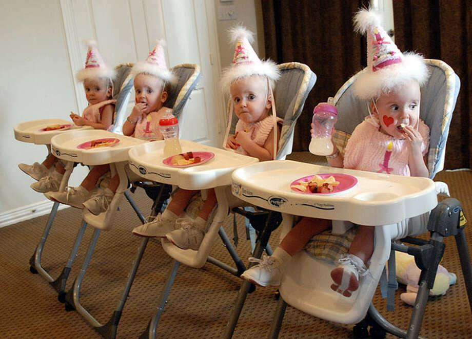 Adelle, Bonnie, Chloe and Daphne Breedlove eat chips and hot dogs before celebrating their second birthday. Related story. Photo: Kim Christensen, . / Freelance