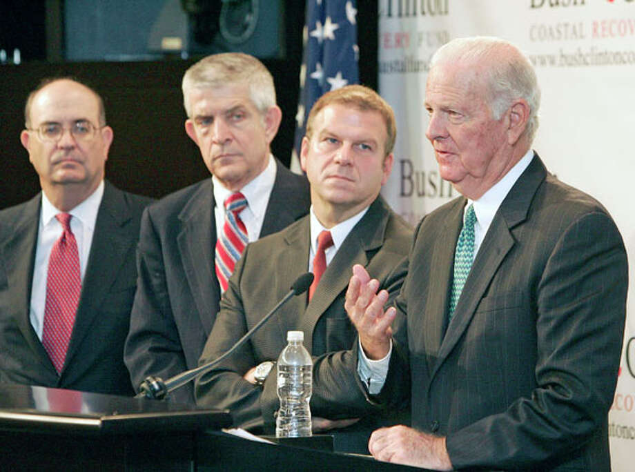 Former Secretary of State James A. Baker, III announces the details of a Gulf Coast hurricane recovery fund in September 2008 with Steven Miller, left, Jim McIngvale and Tilman Fertitta. Related story. Photo: Craig Hartley, . / Freelance