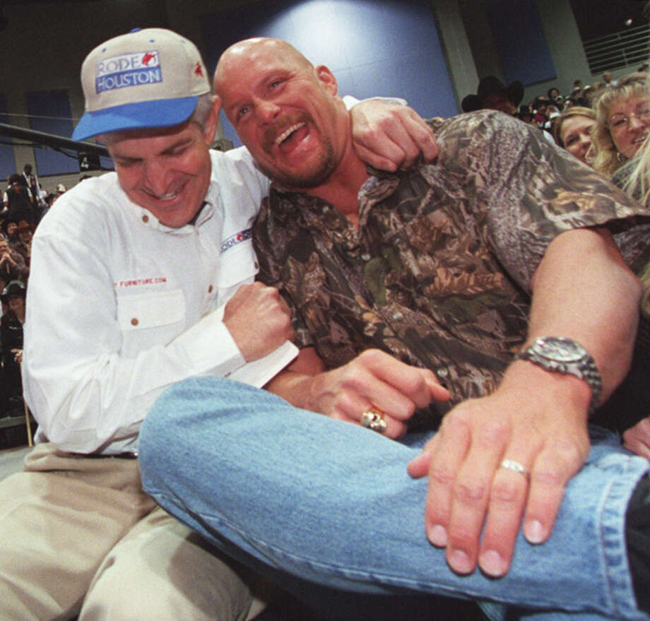 Jim McIngvale and pro wrestler Stone Cold Steve Austin win Shorty the shorthorn steer with a record $600,000 bid on March 3, 2001. Related story. Photo: John Everett, . / Houston Chronicle