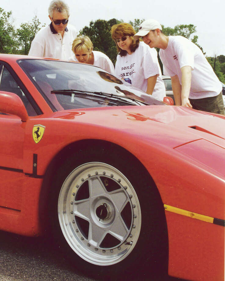 Alan Barklay and prom games chairwoman Sandy Barklay, left, check out Jim McIngvale's Ferrari with Lizette Moran, 