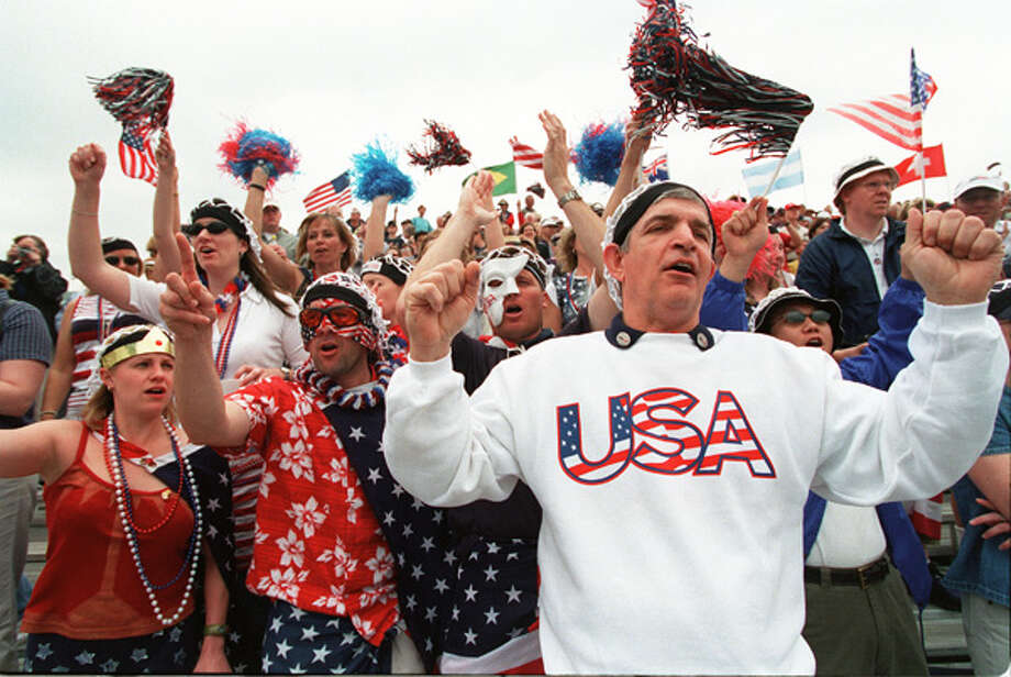 "Jim ""Mattress Mack"" McIngvale, right,  joins fans known as The Netheads for the opening ceremony at Davis Cup quarterfinals doubles match on Saturday, April 6, 2002 at Westside. Related story. Photo: Melissa Phillip, . / Houston Chronicle"
