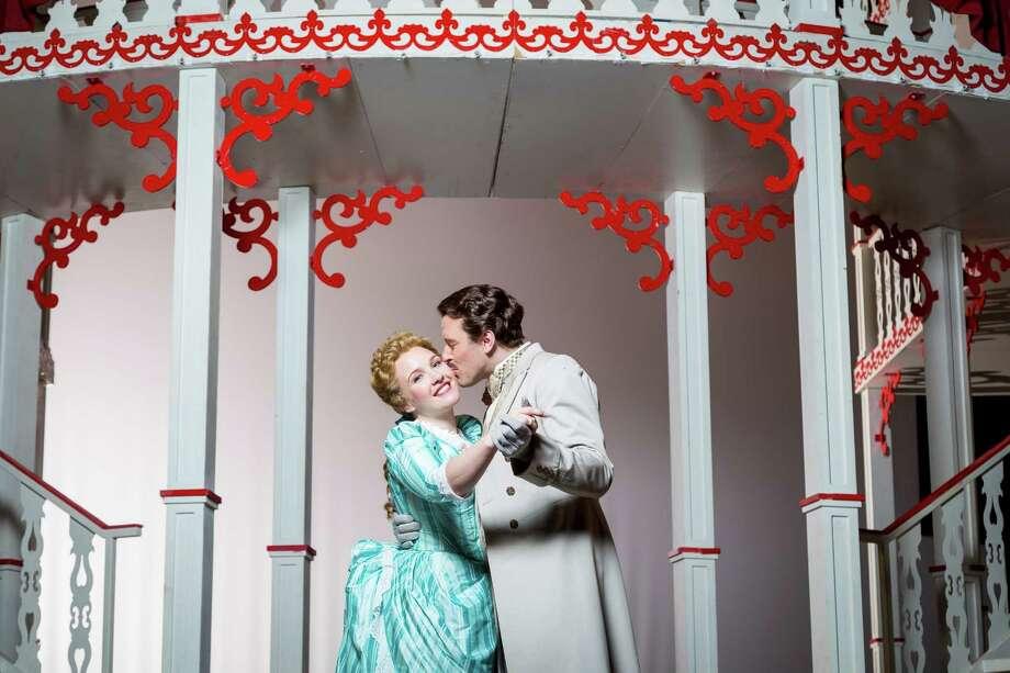 "Magnolia (Sasha Cooke) falls for charming gambler Gaylord (Joseph Kaiser) in HGO's ""Show Boat."" Photo: Michael Paulsen, Staff / © 2013 Houston Chronicle"