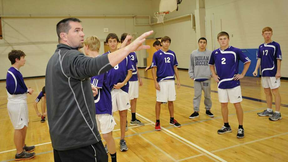 On Wednesday, due to lightning and heavy rain, Chad Luttrull, left, had his boys soccer team do some work indoors in a vacant gym. Luttrull is the first-year head coach for the Port Neches-Groves boy's soccer team. He came from Lumberton High School where he won six district championships in his six years as coach.  Luttrull is taking over a PN-G team that has already had their fair share of success as well.  Dave Ryan/The Enterprise Photo: Dave Ryan