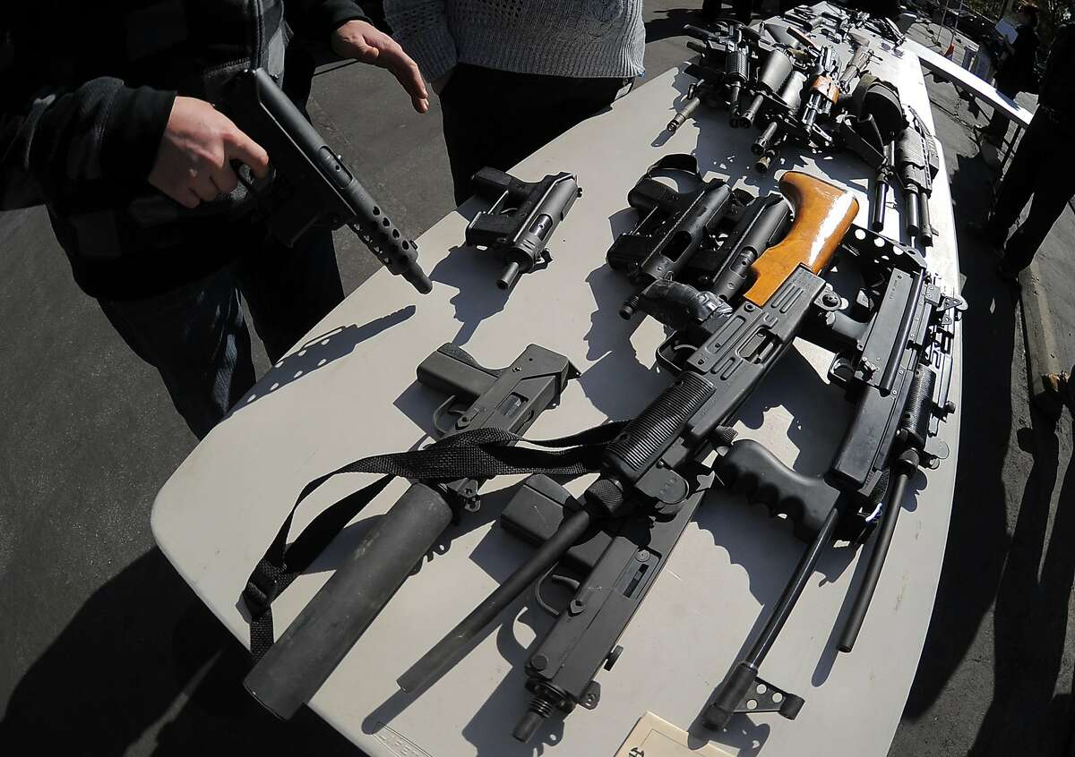 An LAPD officer stands before collected assault weapons during the LAPD Gun Buyback Program event in the Van Nuys area of north Los Angeles, on December 26, 2012. Los Angeles' no-questions-asked gun buyback event, where weapons could be exchanged for up to $200, was held five months early after the Connecticut school shooting. Gun owners could take their arms to one of two locations in return for a $100 grocery store gift card for handguns, rifles and shotguns, or a $200 card for automatic weapons. AFP PHOTO / JOE KLAMARJOE KLAMAR/AFP/Getty Images