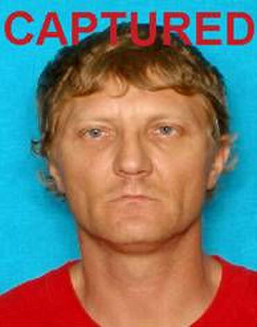 Jimmy Ray McMillan turned himself in Wednesday to authorities in New Orleans.