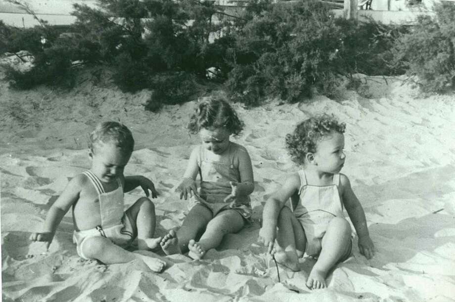 Then: Me with my cousins on Galveston Beach, 1941. Dick Dunlap, Maurene Miller and Ted Pool.