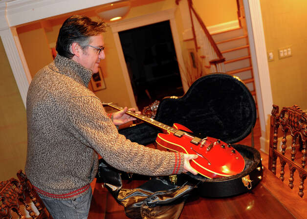 David Schneider shows his new custom Gibson guitar at his home in Fairfield, Conn. on Thursday January 11, 2013. It was given to him by Gibson after hearing of his plight of a broken Gibson guitar due to baggage handlers at Delta Airlines. Photo: Christian Abraham / Connecticut Post