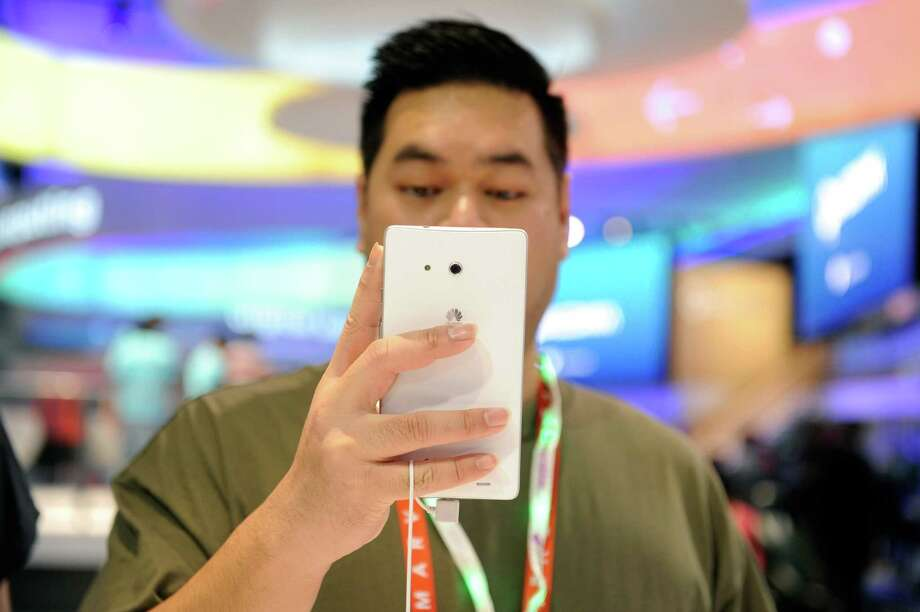 Phablet -a smartphone having a screen which is intermediate in size between that of a typical smartphone and a tablet computer. Origin: early 21st century; blend of phone and tablet. Photo: David Becker, Getty Images / 2013 Getty Images