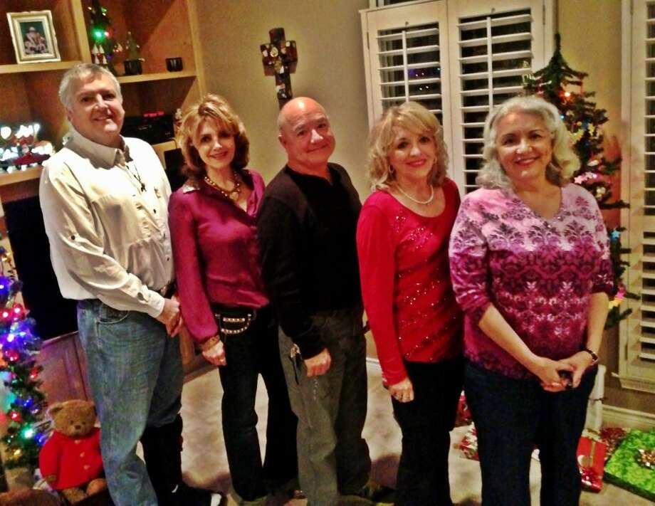 Now:From left, Isaac Uresti,54, Terry Botkin, 55, Jesse Jr. Uresti, 57, Camille Gibson, 58, Susan Tam, 61. on Dec.  25, 2012