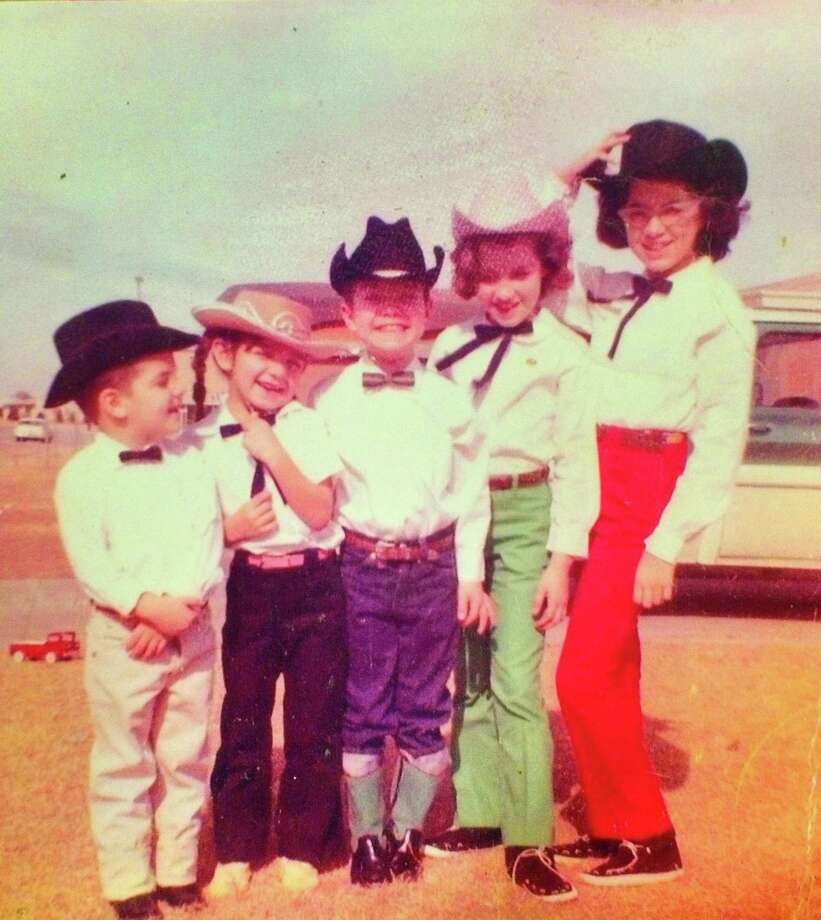 Then: (Left to right) Isaac Uresti, 2, Terry Botkin, 4, Jesse Jr. Uresti, 6, Camille Gibson, 7, Susan Tam, 10, on Dec. 25, 1963 Photo: Uresti, Reader Submission